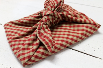 Tie a knot to make a handle for carrying.